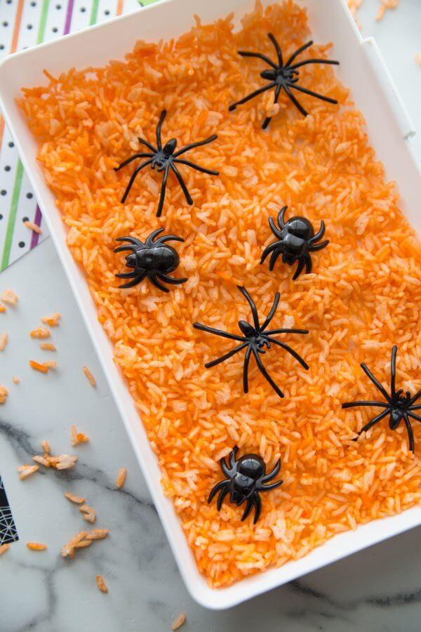 Halloween Sensory bin with colored rice