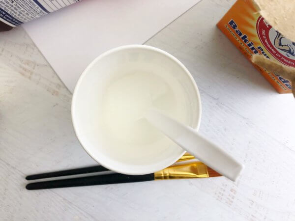 Mix baking soda and hot water.
