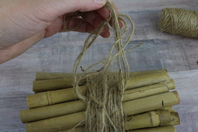 knotting string around bamboo sticks